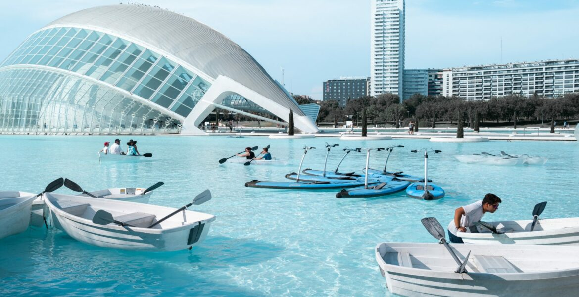 boat-lot-on-water-with-people-near-building-during-daytime (1)